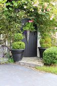 stock photo of english cottage garden  - Small charming rose garden gate - JPG