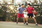 picture of offensive  - Two street basketball players on the basketball court - JPG