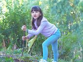 picture of pharyngitis  - Young girl walking at the green forrest - JPG