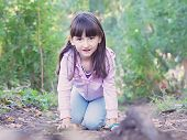 foto of pharyngitis  - Young girl walking at the green forrest - JPG