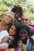 picture of biracial  - Happy multicultural family having a nice summer day