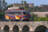 Public Transport Bus Traverses Bridge Over Betwa River.