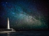 stock photo of eerie  - lighthouse at night - JPG