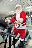 Santa Claus  doing exercises before delivering presents