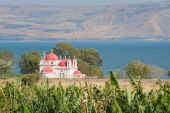 stock photo of golan-heights  - Capernaum The greek orthodox church with the Sea of Galillee and the Golan heights - JPG