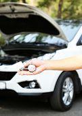 stock photo of air pressure gauge  - Hand holding pressure gauge for car tyre pressure measurement - JPG