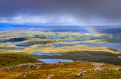 foto of boggy  - Scenic view of beautiful lakes clouds and rainbow in Inverpolly area highlands of Scotland United Kingdom