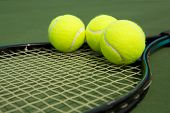 image of court room  - Tennis Balls on a Racket with room for copy - JPG