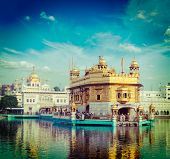stock photo of sikh  - Vintage retro hipster style travel image of famous India attraction Sikh gurdwara Golden Temple  - JPG