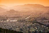 Busan, South Korea hazy sunset skyline.