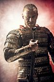 pic of swords  - Portrait of a courageous ancient warrior in armor with sword - JPG