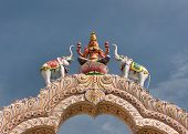 stock photo of lakshmi  - Goddess Lakshmi on top of the entrance gate at Sripuram the Golden Temple in Vellore Tamil Nadu India.
