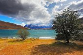 Thundercloud closes the sky. The gale on the Emerald Lake. In the distance the mountains with snow-