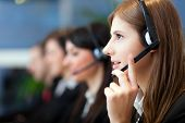 stock photo of telephone operator  - Busy call center operators in a modern office - JPG