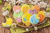 stock photo of dessert plate  - Colorful easter cookies on a plate - JPG