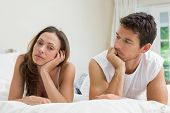 picture of not talking  - Unhappy couple not talking after an argument in bed at home - JPG