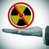 a man hand with a no nuclear power sign in his hand