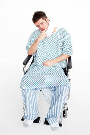 picture of neck brace  - Attractive patient sitting in a wheelchair with a neck brace in hospital - JPG