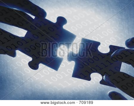 Picture or Photo of Hands trying to fit two puzzle pieces together, on a binary code background