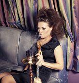 image of hookah  - Beautiful woman smoking hookah in nightclub - JPG