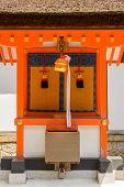 foto of inari  - Japanese temple bell and the donation box in front of the altarin Fushimi Inari Taisha Shrine - JPG
