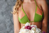 foto of bosom  - Bosom of blonde model in knitted bikini - JPG