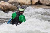 picture of kayak  - Expert male kayaker in short white water kayak in the rapids of River Arkansas at Buena Vista in Colorado - JPG