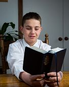 stock photo of scriptures  - A young man studying the scriptures at home - JPG