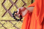 picture of prayer beads  - a prayer beads in monk - JPG
