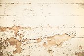stock photo of nostalgic  - Old wooden nostalgic background with peeled color in beige brown or yellow - JPG