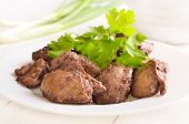 stock photo of liver fry  - Cooked chicken liver with green onion on white plate - JPG