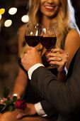 stock photo of propose  - Couple drinking wine after proposal in the city - JPG