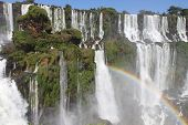 stock photo of hughes  - Iguazu waterfalls with rainbow on a sunny day. The largest waterfall on earth ** Note: Slight blurriness, best at smaller sizes - JPG