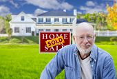 picture of yard sale  - Senior Adult Man in Front of Sold Home For Sale Real Estate Sign and Beautiful House - JPG
