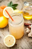 stock photo of cold drink  - Healthy drink with lemon cinammon ginger and honey to prevent cold - JPG