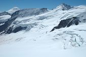 image of firn  - Crevasses ice and snow on Jungfraufirn nearby Jungfraujoch pass in Alps in Switzerland - JPG