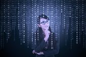 picture of binary code  - Young Asian female entrepreneur looking at computer screen with binary code - JPG