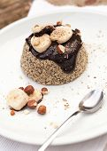 stock photo of chocolate spoon  - Healthy paleo mug cake with dark chocolate banana and hazelnuts - JPG