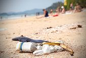 pic of polluted  - Garbage on a beach left by tourists environmental pollution concept picture - JPG