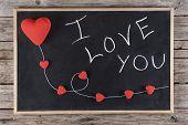 stock photo of kites  - I love you written on blackboard whit red hearts kite on wooden background - JPG