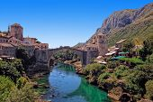 image of old bridge  - The Old Bridge in Mostar with emerald river Neretva - JPG