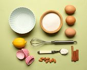 pic of kitchen utensils  - Food ingredients and kitchen utensils for cooking on green background - JPG