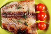 picture of pangasius  - Dish of Pangasius fillet with rosemary and cherry tomatoes on plate background - JPG
