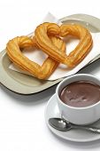 picture of churros  - heart shape churros and hot chocolate on white background - JPG