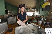 pic of stereotype  - 1950 Era Housewife Doing Her Daily Chores - JPG