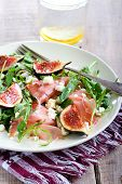 pic of rocket salad  - Rocket feta fig and prosciutto salad on plate - JPG