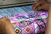 stock photo of handloom  - Traditional hand weaving by locals in Nan Province Thailand - JPG