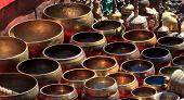 image of singing  - Several singing bowls displayed at a market in Kathmandu Nepal - JPG