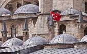 pic of sufi  - Turkish flag on exterior of Rumi Museum in Konya - JPG