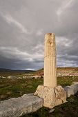 stock photo of ionic  - Remains of Ionic column near ampitheater at Antioch Pisidian in Turkey - JPG